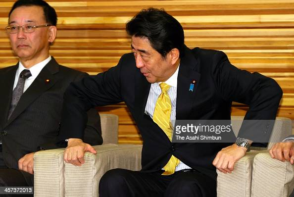Japanese Prime Minister Shinzo Abe attends the cabinet meeting at his official residence on December 17 2013 in Tokyo Japan The Cabinet of Prime...