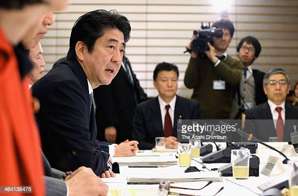 Japanese Prime Minister Shinzo Abe attends the Council on Economic and Fiscal Policy at his official residence on January 20 2014 in Tokyo Japan Abe...