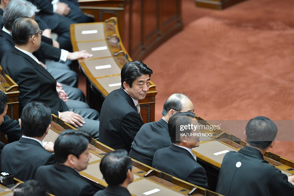 Japanese Prime Minister Shinzo Abe (C) attends the opening ceremony of a new 150-day parliament session at the parliament in Tokyo on January 28, 2013. Abe pledged on January 28 he would not keep stimulus spending 'forever' in a policy speech ahead of a budget that will raise more in taxes than it does from borrowing. AFP PHOTO / KAZUHIRO NOGI