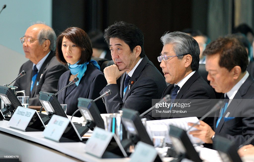 Japanese Prime Minister <a gi-track='captionPersonalityLinkClicked' href=/galleries/search?phrase=Shinzo+Abe&family=editorial&specificpeople=559017 ng-click='$event.stopPropagation()'>Shinzo Abe</a> (C) attends the Tokyo's 2020 Olympic bid presentation at a hotel on March 4, 2013 in Tokyo, Japan. The International Olympic Committee (IOC) Evaluation Commission begins the four-day inspection.