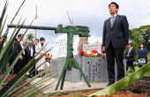 Japanese Prime Minister Shinzo Abe attends the unveiling ceremony of the memorial to commemorate the war deads in WWII on July 11 Wewak Papua New...