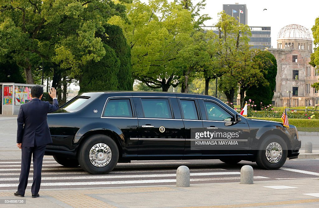 Japanese Prime Minister Shinzo Abe (L) bids farewell to US President Barack Obama (R) after visiting Hiroshima Peace Memorial Park in Hiroshima on May 27, 2016. Obama on May 27 paid moving tribute to victims of the world's first nuclear attack. MAYAMA