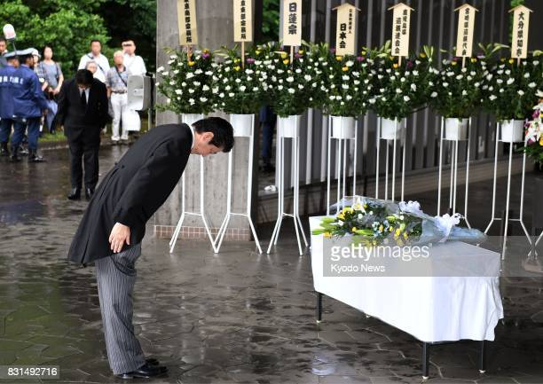 Japanese Prime Minister Shinzo Abe bows after offering flowers at the Chidorigafuchi National Cemetery in Tokyo on Aug 15 the 72nd anniversary of the...