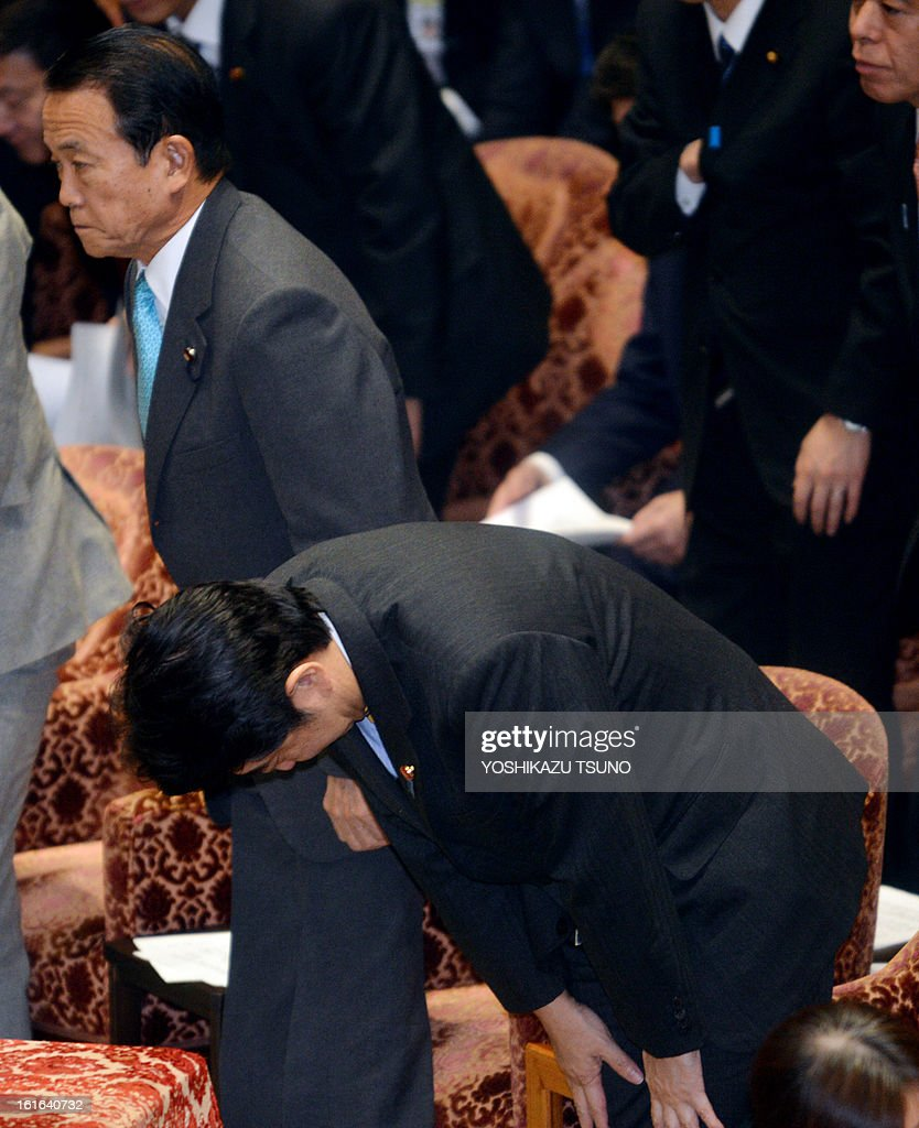 Japanese Prime Minister Shinzo Abe bows at the Lower House's budget committee session at the National Diet in Tokyo on February 14, 2013. The governemnt and ruling coalition passed a 140 billion USD supplementary budget for the fiscal 2012 to finance economic stimulus. AFP PHOTO / Yoshikazu TSUNO