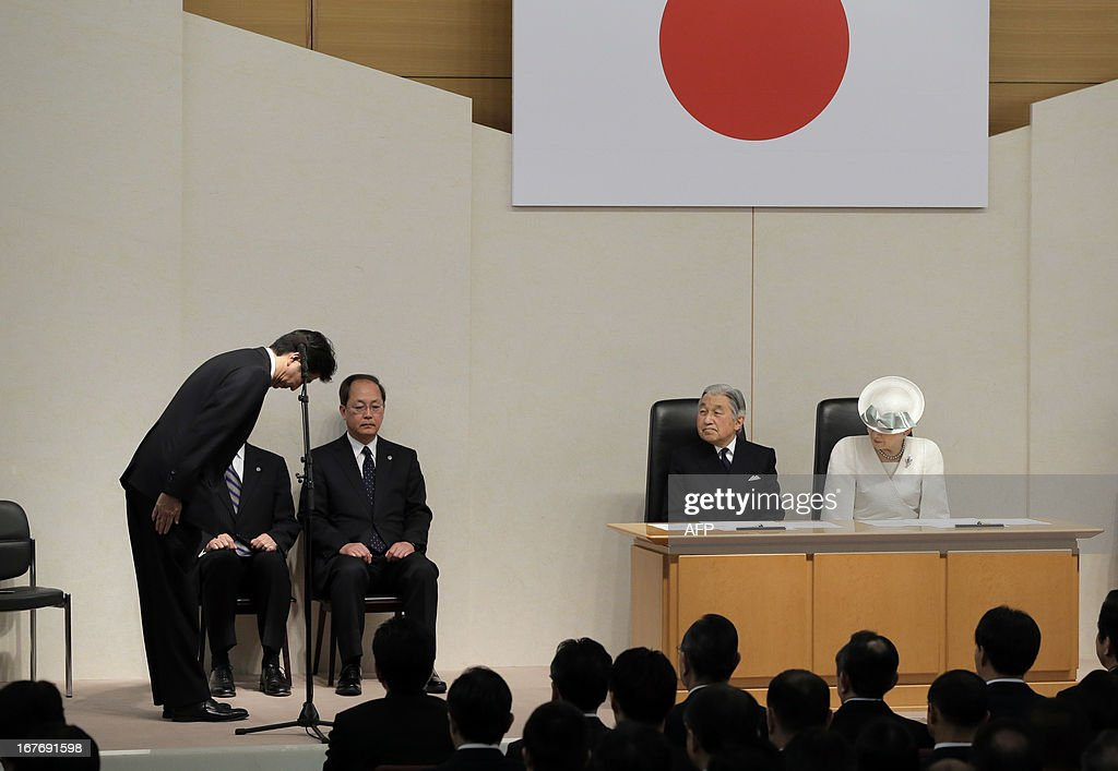 Japanese Prime Minister Shinzo Abe (L) bows to Emperor Akihito(2nd R) and Empress Michiko before giving a speech during a ceremony in Tokyo on April 28, 2013 to mark the day Japan recovered its sovereignty under the San Francisco Peace Treaty in 1952. The royal couple attended the ceremony to commemorate the end of the US-led allied occupation of the country after World War II. AFP PHOTO / Itsuo Inouye / POOL