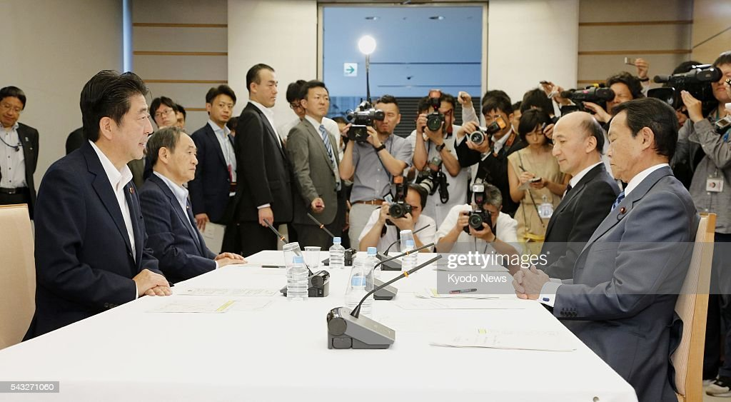 Japanese Prime Minister <a gi-track='captionPersonalityLinkClicked' href=/galleries/search?phrase=Shinzo+Abe&family=editorial&specificpeople=559017 ng-click='$event.stopPropagation()'>Shinzo Abe</a> (far L), Chief Cabinet Secretary <a gi-track='captionPersonalityLinkClicked' href=/galleries/search?phrase=Yoshihide+Suga&family=editorial&specificpeople=3868279 ng-click='$event.stopPropagation()'>Yoshihide Suga</a> (2nd from L), Finance Minister <a gi-track='captionPersonalityLinkClicked' href=/galleries/search?phrase=Taro+Aso&family=editorial&specificpeople=559212 ng-click='$event.stopPropagation()'>Taro Aso</a> (far R) and Hiroshi Nakaso (2nd from R), a deputy governor of the Bank of Japan, attend a meeting at the prime minister's office in Tokyo on June 27, 2016. In the meeting to discuss emergency steps following the British decision to leave the European Union in a referendum, Abe instructed the central bank to ensure stability in financial markets.
