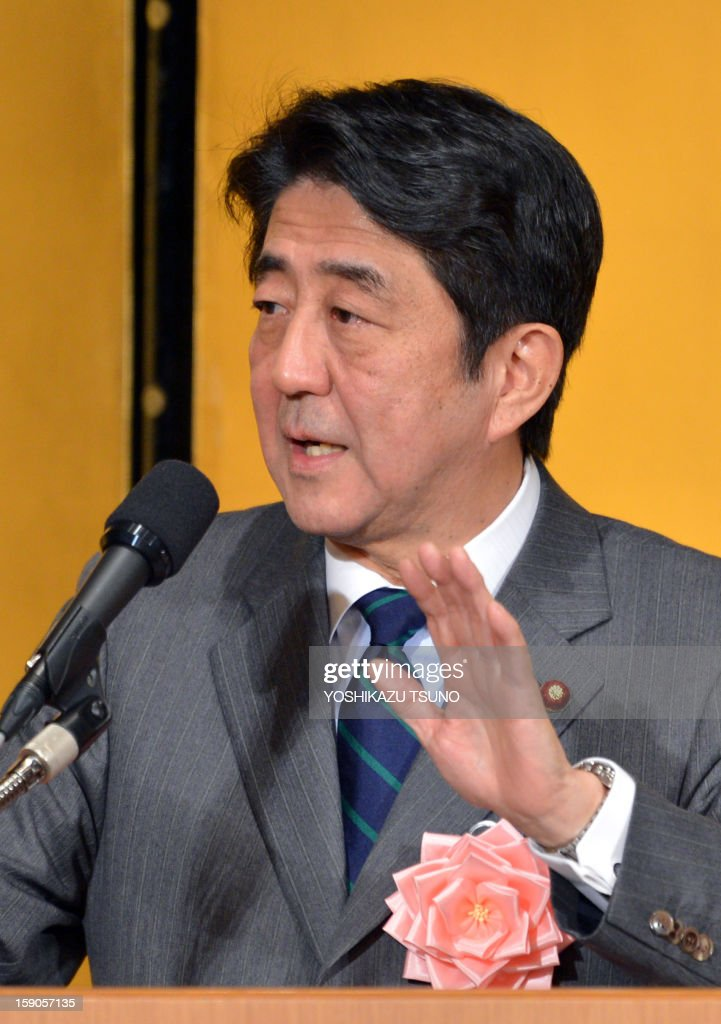 Japanese Prime Minister Shinzo Abe delivers a speech before Japan's business leaders at a New Year's party at a Tokyo hotel on January 7, 2013. Japan's major business lobbies said they support Prime Minister Abe for his efforts to revive the dwindling economy, urging him an early participation in a Pacific-wide free trade deal. AFP PHOTO / Yoshikazu TSUNO