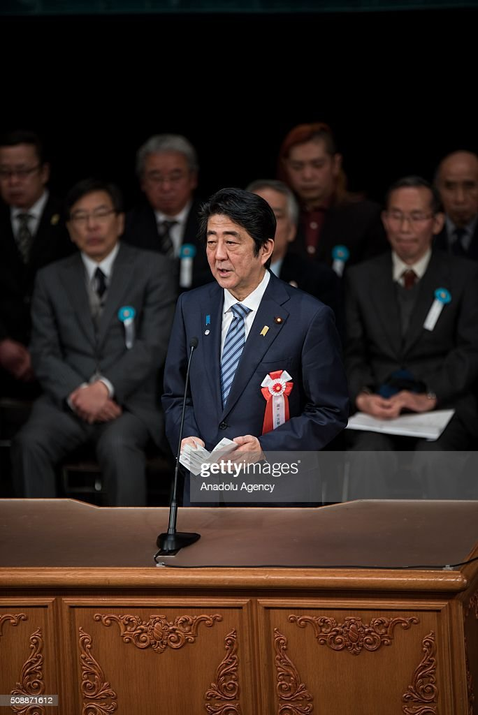 Japanese Prime Minister Shinzo Abe delivers a speech calling for the return of the Russia-controlled Southern Kurils, which Japan claims as the Northern Territories, in Tokyo on February 7, 2015. Soviet troops took the islands in the final days of World War II, turfing out several hundred Japanese who lived there at the time. The issue has prevented the signing of a formal peace treaty between the two countries.