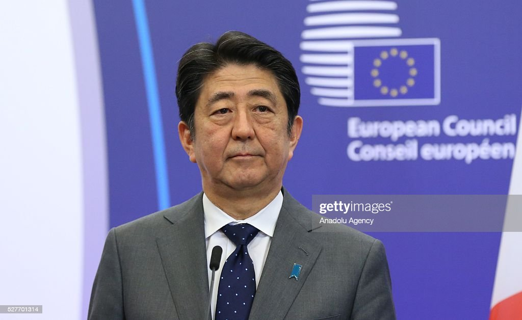 Japanese Prime Minister Shinzo Abe delivers a speech during a joint press conference with the President of the European Council Donald Tusk (not seen) and President of the European Commission Jean-Claude Juncker (not seen) after the EU - Japan leaders' meeting at the EU headquarters in Brussels on May 3, 2016.