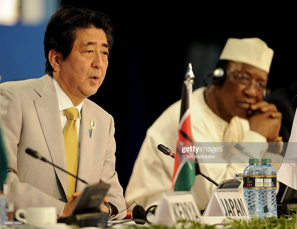 Japanese Prime Minister Shinzo Abe delivers his closing remarks as President of Chad Idriss Deby looks onat the end of the sixth Tokyo International...
