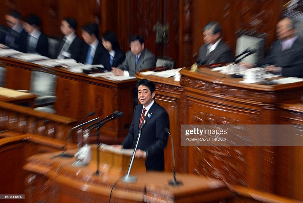 Japanese Prime Minister Shinzo Abe delivers his policy speech at the Lower House's plenary session at the National Diet in Tokyo on February 28, 2013. Faced with a territorial dispute with China, Abe quoted former British prime minister Margaret Thatcher stressing the rule of law over the 1982 Falklands war. AFP PHOTO / Yoshikazu TSUNO