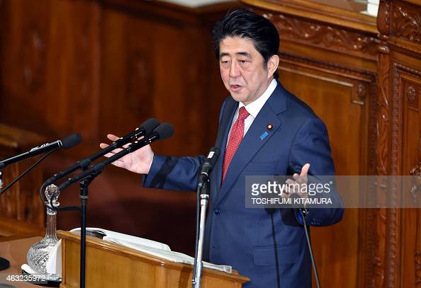 Japanese Prime Minister Shinzo Abe delivers his policy speech at the lower house of the parliament in Tokyo on February 12 2015 Abe and his cabinets...