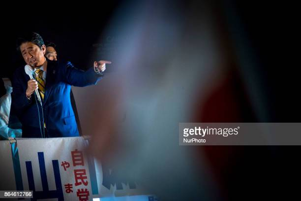 Japanese Prime Minister Shinzo Abe delivers last campaign speech to voters during his final campaign of the Lower House election outside Akihabara JR...