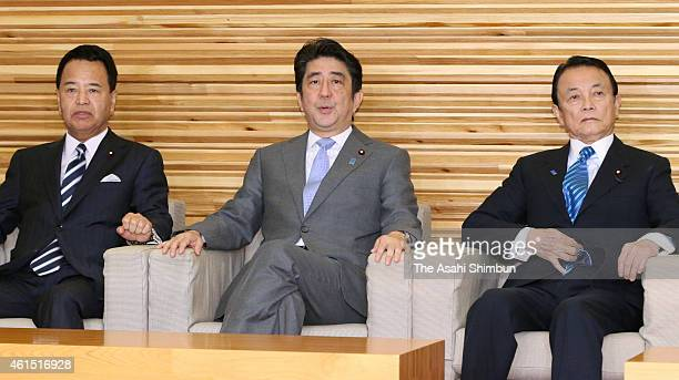 Japanese Prime Minister Shinzo Abe Finance Minister Taro Aso and Economy Revitalization Minister Akira Amari are seen prior to the cabinet members...