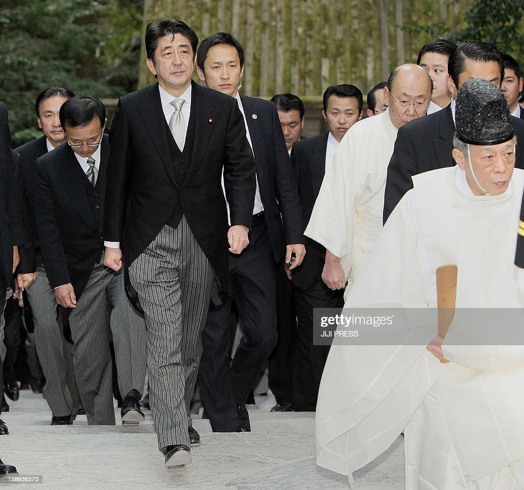 Japanese Prime Minister Shinzo Abe (L) follows a Shinto priest (R) as he visits Ise shrine in the city of Ise, Mie prefecture in central Japan on January 4, 2012. Meanwhile, Abe sent a special envoy to South Korea to meet with South Korean president-elect Park Geun-Hye in the hope of a new start to a relationship dogged by bitter historical disputes. JAPAN