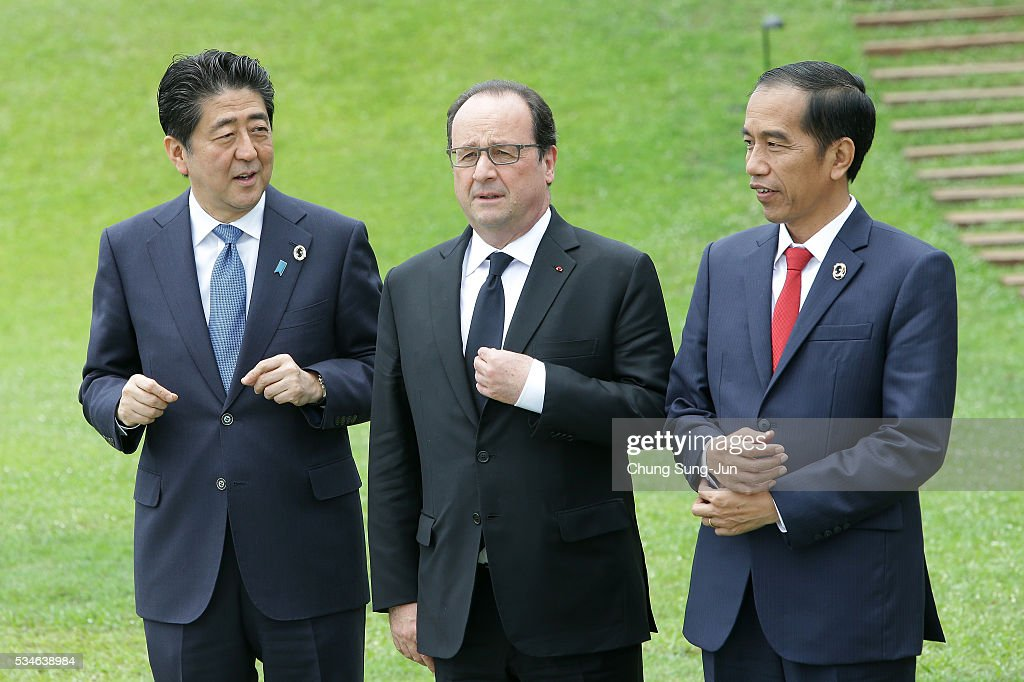 Japanese Prime Minister <a gi-track='captionPersonalityLinkClicked' href=/galleries/search?phrase=Shinzo+Abe&family=editorial&specificpeople=559017 ng-click='$event.stopPropagation()'>Shinzo Abe</a>, French President Francois Hollande and Indonesian President <a gi-track='captionPersonalityLinkClicked' href=/galleries/search?phrase=Joko+Widodo&family=editorial&specificpeople=6657368 ng-click='$event.stopPropagation()'>Joko Widodo</a> attend the 'Outreach Session' session on May 27, 2016 in Kashikojima, Japan. In the two-day summit, the G7 leaders are scheduled to discuss the pressing global issues including counter-terrorism, energy policy, and sustainable development.