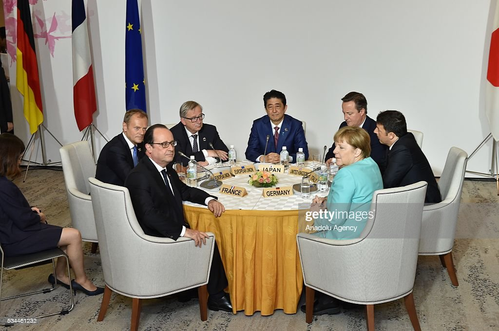 Japanese Prime Minister Shinzo Abe (center), German Chancellor Angela Merkel, Italian Prime Minister Matteo Renzi (right), European Council President Donald Tusk (right), European Commission President Jean-Claude Juncker, British Prime Minister David Cameron and French President Francois Hollande (f are seen during the working lunch at the Shima Kanko Hotel in in Ise, Japan on May 26, 2016 on the first day of the G7 leaders summit in the city of Ise in Mie prefecture.