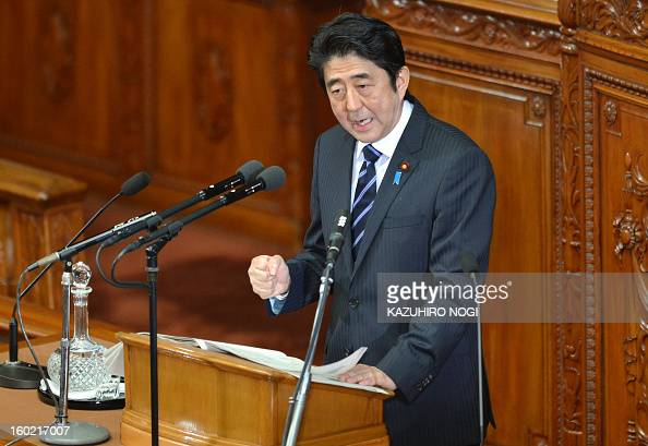 Japanese Prime Minister Shinzo Abe gestures as he delivers his first policy speech in the lower house plenary session at the parliament in Tokyo on...