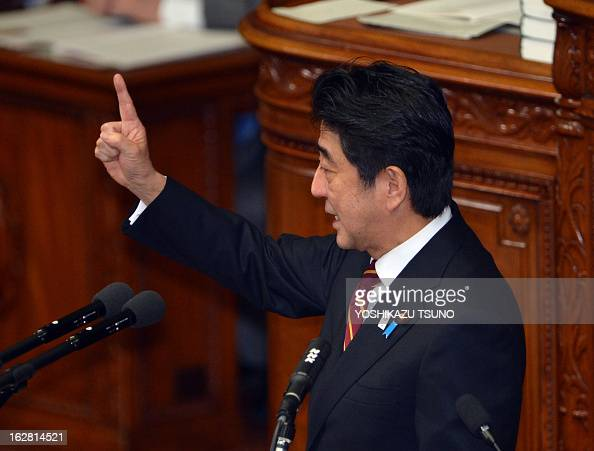 Japanese Prime Minister Shinzo Abe gestures as he delivers his policy speech at the Lower House's plenary session at the National Diet in Tokyo on...