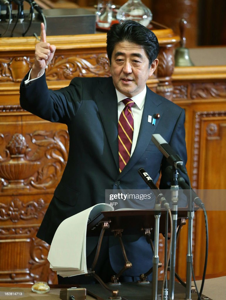 Japanese Prime Minister Shinzo Abe gestures as he delivers his policy speech at the Lower House's plenary session at the National Diet in Tokyo on February 28, 2013. Faced with a territorial dispute with China, Abe quoted former British prime minister Margaret Thatcher stressing the rule of law over the 1982 Falklands war. AFP PHOTO / JIJI PRESS JAPAN OUT