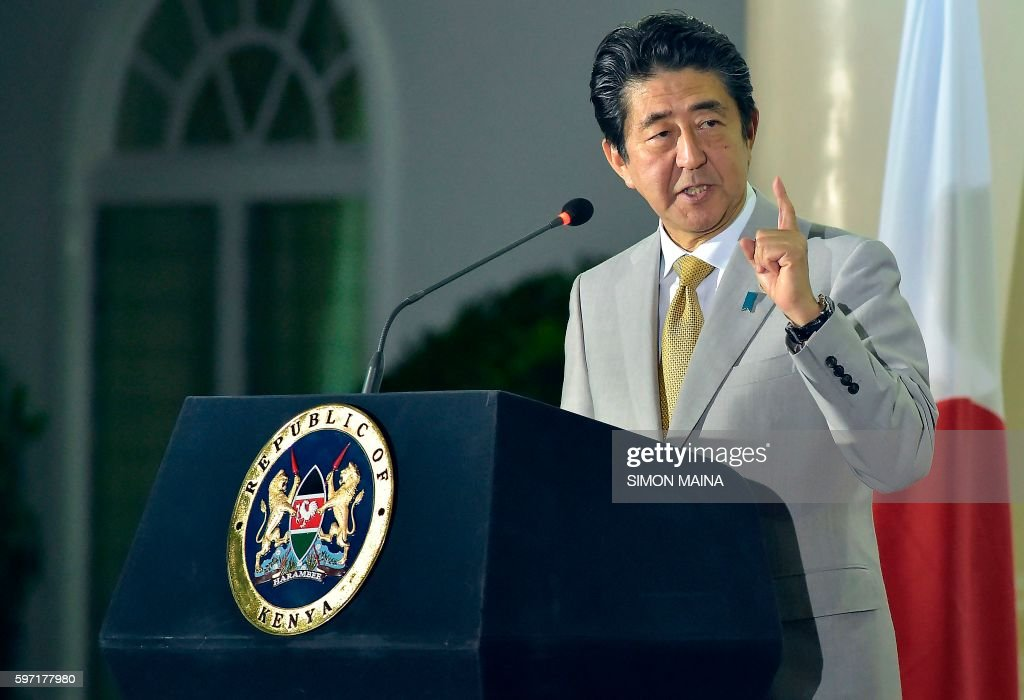 Japanese Prime Minister Shinzo Abe gestures as he speaks during a joint press conference with Kenya's President at the State House at the end of the...