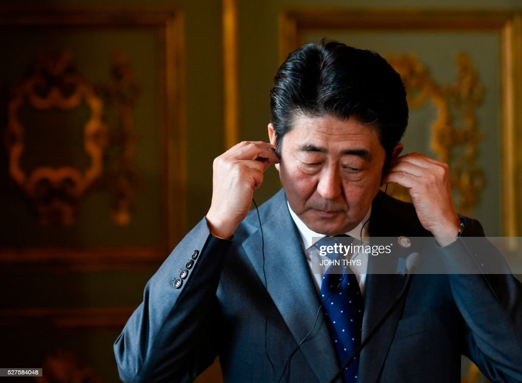 Japanese Prime Minister Shinzo Abe gestures during a joint press conference with Belgian Prime minister after their meeting in Brussels on May 3, 2016. / AFP / JOHN