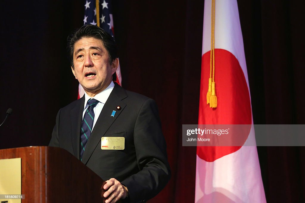 Japanese Prime Minister <a gi-track='captionPersonalityLinkClicked' href=/galleries/search?phrase=Shinzo+Abe&family=editorial&specificpeople=559017 ng-click='$event.stopPropagation()'>Shinzo Abe</a> gives a speech to guests at the New York Stock Exchange before ringing the closing bell on September 25, 2013 in New York City. Abe spoke on 'Abenomics' and Japan's economic recovery.