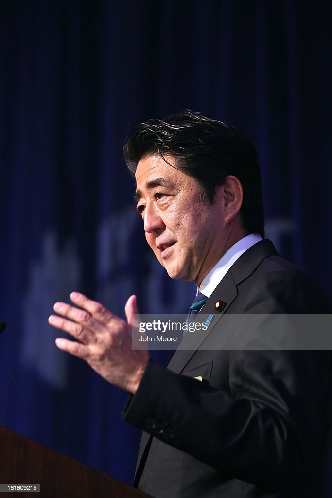 Japanese Prime Minister <a gi-track='captionPersonalityLinkClicked' href=/galleries/search?phrase=Shinzo+Abe&family=editorial&specificpeople=559017 ng-click='$event.stopPropagation()'>Shinzo Abe</a> gives a speech to guests at the New York Stock Exchange before ringing the closing bell on September 25, 2013 in New York City. Abe spoke on 'Abenomics' and his country's economic recovery.