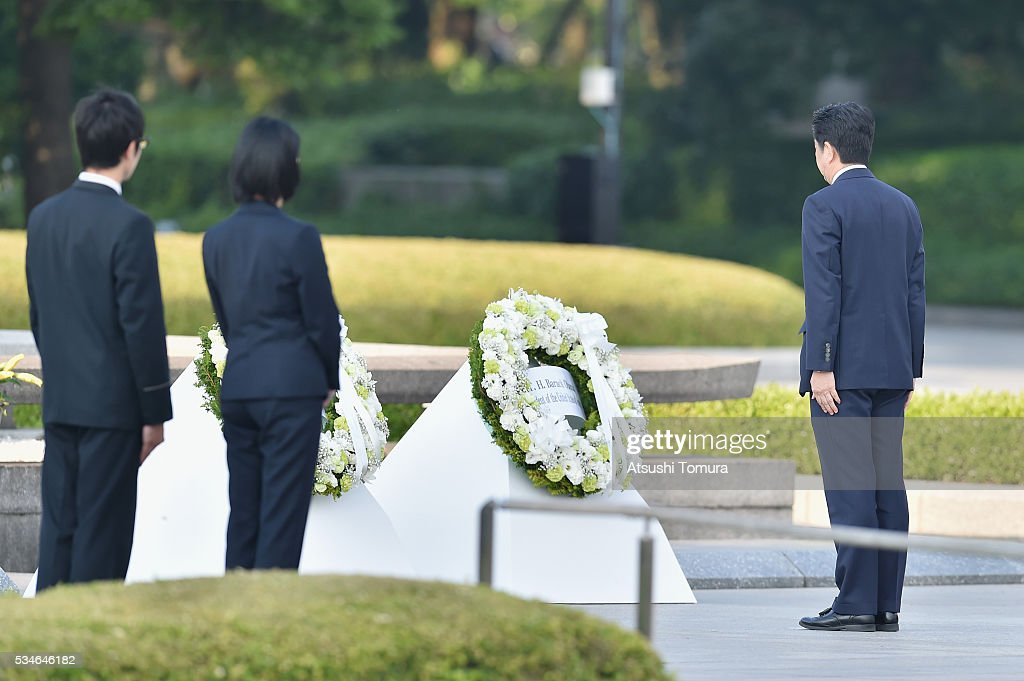 Japanese Prime Minister <a gi-track='captionPersonalityLinkClicked' href=/galleries/search?phrase=Shinzo+Abe&family=editorial&specificpeople=559017 ng-click='$event.stopPropagation()'>Shinzo Abe</a> (R) gives flower during U.S. President Obama's visit to the Hiroshima Peace Memorial Park on May 27, 2016 in Hiroshima, Japan. It is the first time U.S. President makes an official visit to Hiroshima, the site where the atomic bomb was dropped in the end of World War II on August 6, 1945.