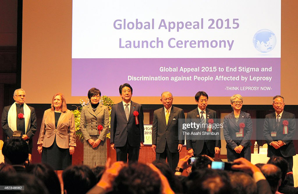 Japanese Prime Minister <a gi-track='captionPersonalityLinkClicked' href=/galleries/search?phrase=Shinzo+Abe&family=editorial&specificpeople=559017 ng-click='$event.stopPropagation()'>Shinzo Abe</a> (4th L), his wife Akie (3rd R), Japanese Health Minister <a gi-track='captionPersonalityLinkClicked' href=/galleries/search?phrase=Yasuhisa+Shiozaki&family=editorial&specificpeople=642749 ng-click='$event.stopPropagation()'>Yasuhisa Shiozaki</a> (3rd R) and other members pose for photographs during the Global Appeal 2015 Launch Ceremony to end Stigma and Discrimination against People Affected by Leprosy, at ANA Intercontinental Hotel on January 27, 2015 in Tokyo, Japan.