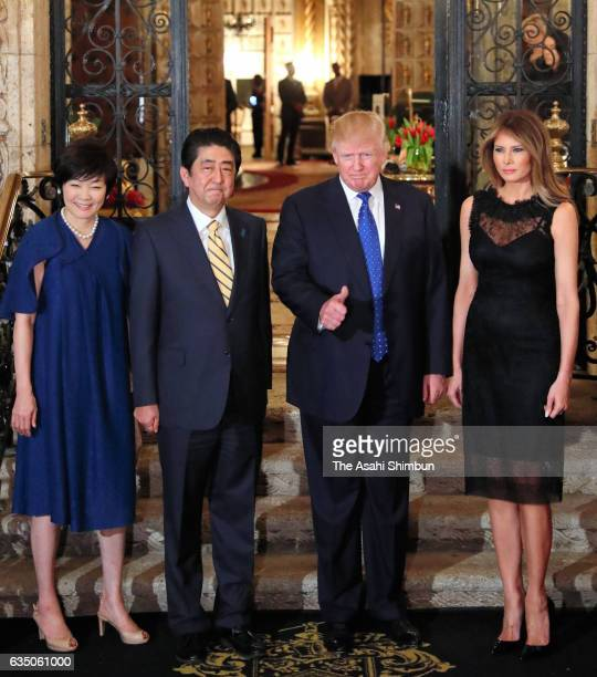 Japanese Prime Minister Shinzo Abe his wife Akie US President Donald Trump and his wife Melania pose for photographs prior to their dinner at Mar a...