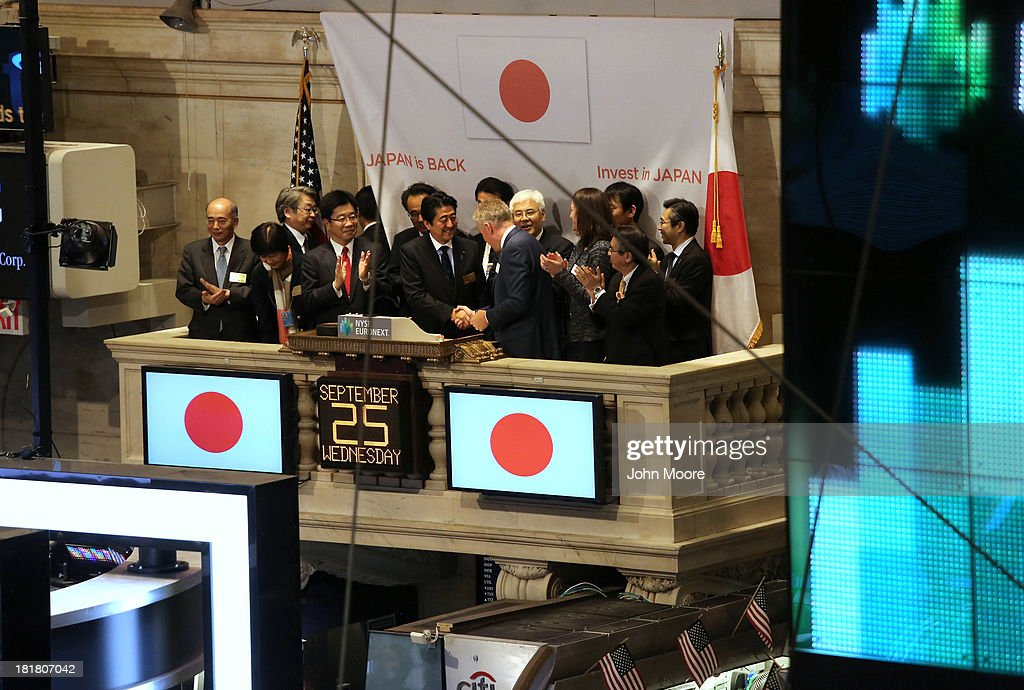 Japanese Prime Minister <a gi-track='captionPersonalityLinkClicked' href=/galleries/search?phrase=Shinzo+Abe&family=editorial&specificpeople=559017 ng-click='$event.stopPropagation()'>Shinzo Abe</a> (C) is congratulated before ringing the closing bell at the New York Stock Exchange on September 25, 2013 in New York City. He gave a speech at the NYSE on 'Abenomics' and his country's economic recovery.