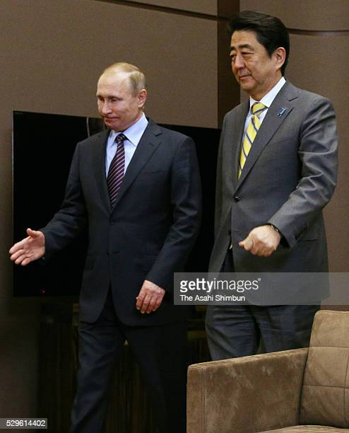 Japanese Prime Minister Shinzo Abe is escorted by Russian President Vladimir Putin prior to their meeting on May 6 2016 in Sochi Russia Abe and Putin...