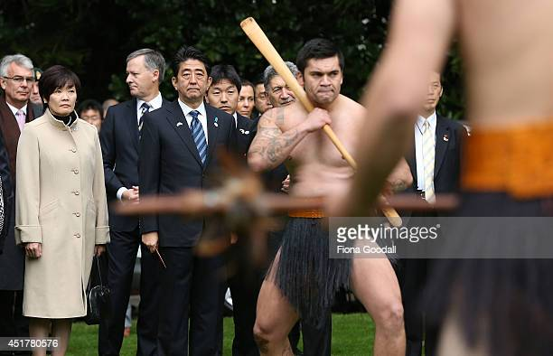 Japanese Prime Minister Shinzo Abe is given a traditional Maori welcome at Government House on July 7 2014 in Auckland New Zealand Prime Minister Abe...