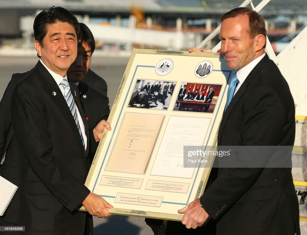 Japanese Prime Minister <a gi-track='captionPersonalityLinkClicked' href=/galleries/search?phrase=Shinzo+Abe&family=editorial&specificpeople=559017 ng-click='$event.stopPropagation()'>Shinzo Abe</a> is presented with a framed gift prior to his departure by Australian Prime Minister <a gi-track='captionPersonalityLinkClicked' href=/galleries/search?phrase=Tony+Abbott&family=editorial&specificpeople=220956 ng-click='$event.stopPropagation()'>Tony Abbott</a> at Perth International Airport on July 10, 2014 in Perth, Australia. Prime Minister is in Australia for three days and will sign a n Economic Partnership Agreement with Australia. Japan is Australia's second biggest trading partner.