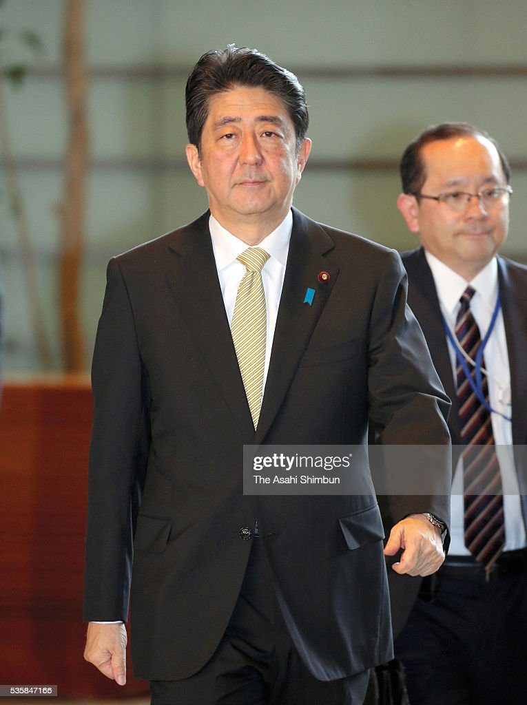 Japanese Prime Minister <a gi-track='captionPersonalityLinkClicked' href=/galleries/search?phrase=Shinzo+Abe&family=editorial&specificpeople=559017 ng-click='$event.stopPropagation()'>Shinzo Abe</a> is seen on arrival at his official residence on May 30, 2016 in Tokyo, Japan. Abe has decided to postpone the scheduled increase in the consumption tax rate, from 8 to 10 percent, citing sluggish global economic conditions and the powerful earthquakes that struck Kyushu. Abe will not dissolve the Lower House for a snap election for voters' opinion on his decision.