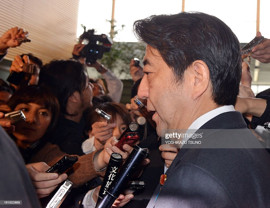 Japanese Prime Minister Shinzo Abe is surrounded by reporters after he attended the security council meeting at his official residence in Tokyo on February 12, 2013 . North Korea staged an apparent nuclear test of six to seven kilotons in a striking act of defiance that, if confirmed, is sure to trigger global condemnation from enemies and allies alike. AFP PHOTO / Yoshikazu TSUNO