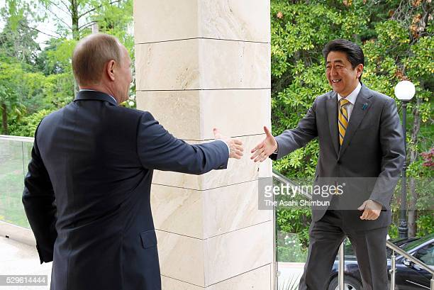 Japanese Prime Minister Shinzo Abe is welcomed by Russian President Vladimir Putin prior to their meeting on May 6 2016 in Sochi Russia Abe and Putin...