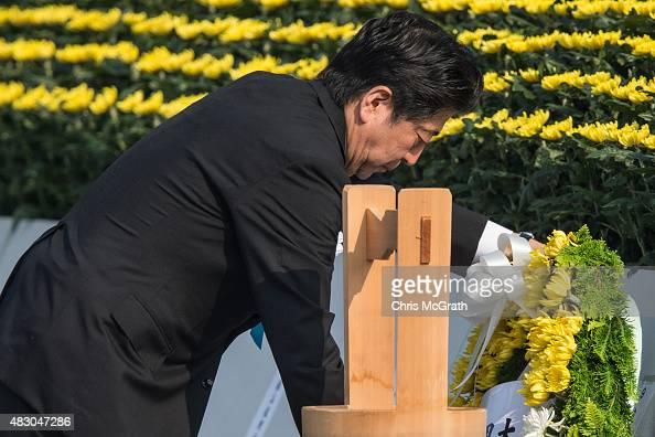 Japanese Prime Minister Shinzo Abe lays a wreath during the 70th anniversary ceremony of the atomic bombing of Hiroshima at the Hiroshima Peace...