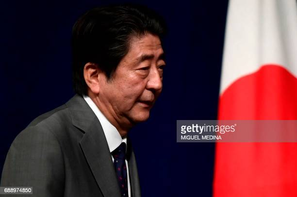Japanese Prime Minister Shinzo Abe leaves after a press conference at the end of a G7 summit of Heads of State and of Government on May 27 2017 in...