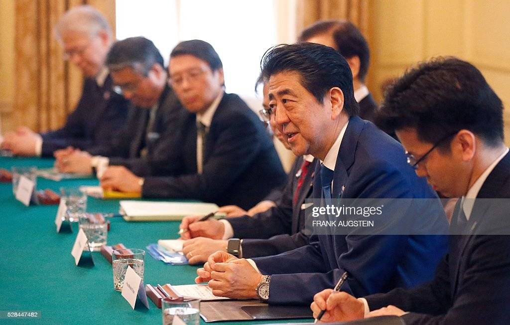 Japanese Prime Minister Shinzo Abe (2R) listens during his meeting with British Prime Minister David Cameron (unseen) during their meeting inside 10 Downing Street in central London on May 5, 2016. / AFP / POOL / Frank Augstein