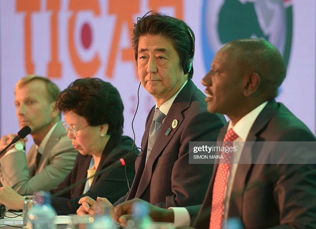 Japanese Prime Minister Shinzo Abe listens to Kenya's Deputy President William Ruto during a session with Kenya's Ministry of Health and world Bank...