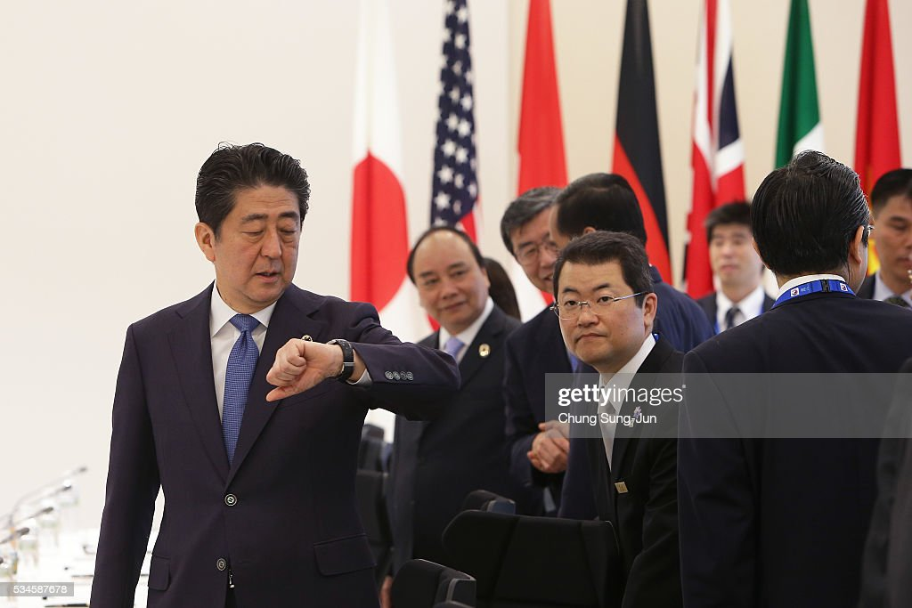 Japanese Prime Minister Shinzo Abe looks at his watch during a first Outreach Session on May 27, 2016 in Kashikojima, Japan. In the two-day summit, the G7 leaders are scheduled to discuss the pressing global issues including counter-terrorism, energy policy, and sustainable development.