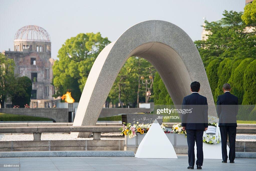 Japanese Prime Minister Shinzo Abe (L) looks on as US President Barack Obama (R) lays a wreath during a visit to the Hiroshima Peace Memorial Park in Hiroshima on May 27, 2016. Obama on May 27 paid moving tribute to victims of the world's first nuclear attack. WATSON