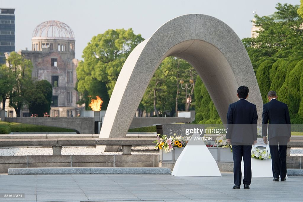Japanese Prime Minister Shinzo Abe (2nd R) looks on as US President Barack Obama (R) lays a wreath during a visit to the Hiroshima Peace Memorial Park in Hiroshima on May 27, 2016. Obama on May 27 paid moving tribute to victims of the world's first nuclear attack. WATSON