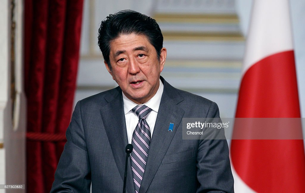 Japanese Prime Minister <a gi-track='captionPersonalityLinkClicked' href=/galleries/search?phrase=Shinzo+Abe&family=editorial&specificpeople=559017 ng-click='$event.stopPropagation()'>Shinzo Abe</a> makes a statement next to the French President Francois Hollande during a joint press conference at the Elysee Presidential Palace on May 2, 2016 in Paris, France. <a gi-track='captionPersonalityLinkClicked' href=/galleries/search?phrase=Shinzo+Abe&family=editorial&specificpeople=559017 ng-click='$event.stopPropagation()'>Shinzo Abe</a> began a week-long trip to several European countries and Russia prior to the G7 Summit to be held on May 26 and 27, 2016 in Japan.