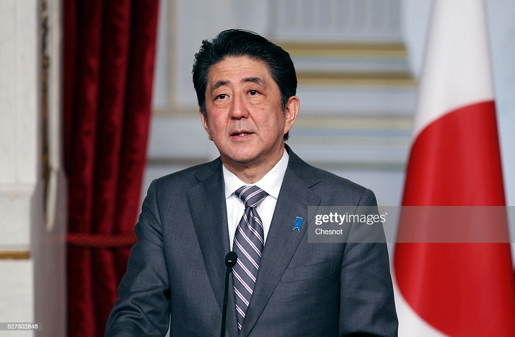 Japanese Prime Minister Shinzo Abe makes a statement next to the French President Francois Hollande during a joint press conference at the Elysee Presidential Palace on May 2, 2016 in Paris, France. Shinzo Abe began a week-long trip to several European countries and Russia prior to the G7 Summit to be held on May 26 and 27, 2016 in Japan.