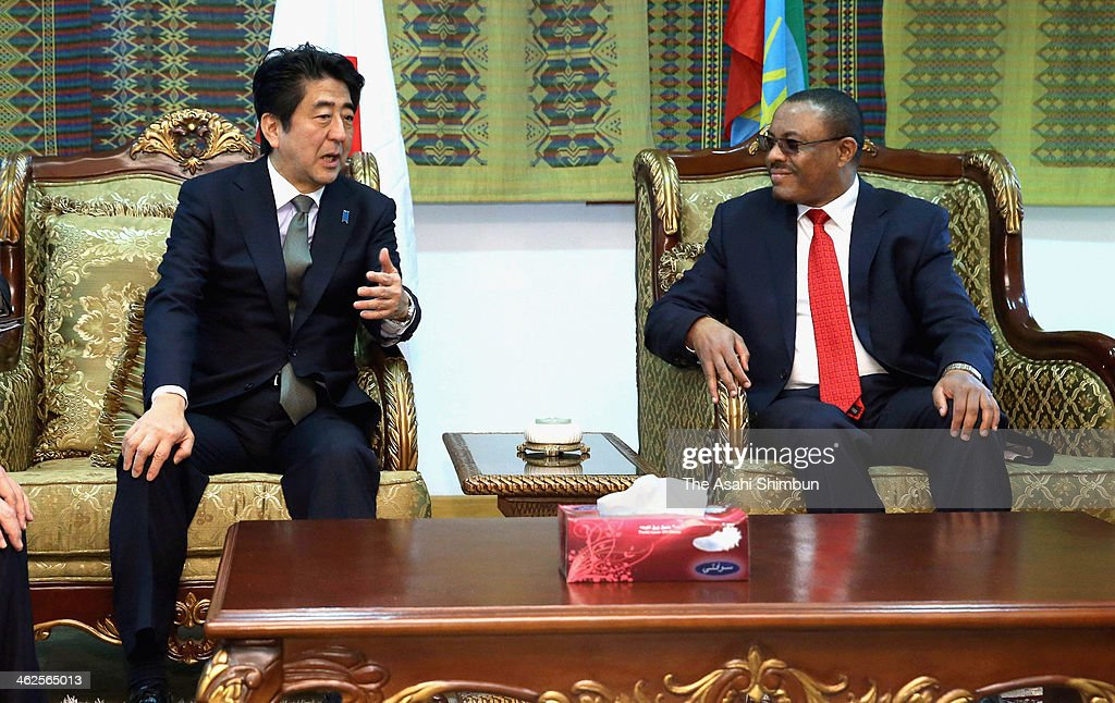Japanese Prime Minister Shinzo Abe meets Ethiopian Prime Minister Hailemariam Desalegn at a VIP room in airport on January 13, 2014 in Addis Ababa, Ethiopia. Abe announced on Monday that Japan agreed to the financial aid worth $11.6 million (1.2 billion yen) to Ethiopia to help refugees affected by civil war.