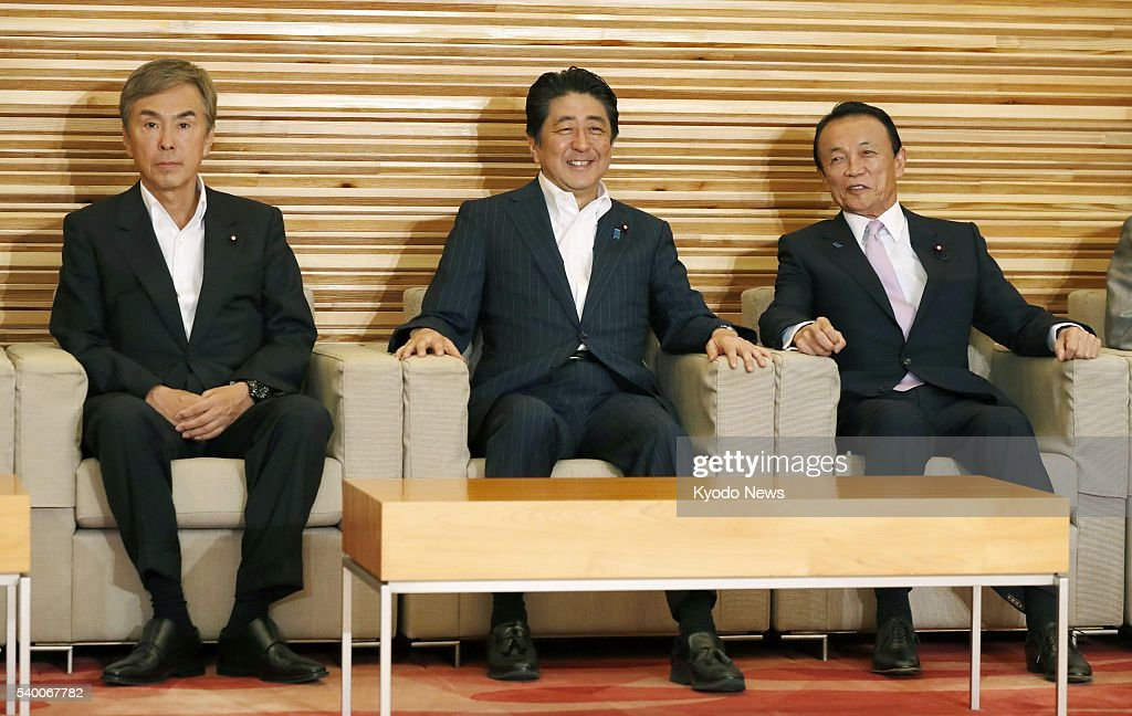 Japanese Prime Minister <a gi-track='captionPersonalityLinkClicked' href=/galleries/search?phrase=Shinzo+Abe&family=editorial&specificpeople=559017 ng-click='$event.stopPropagation()'>Shinzo Abe</a> (C), <a gi-track='captionPersonalityLinkClicked' href=/galleries/search?phrase=Nobuteru+Ishihara&family=editorial&specificpeople=2258645 ng-click='$event.stopPropagation()'>Nobuteru Ishihara</a> (L), minister in charge of economic revitalization, and Finance Minister <a gi-track='captionPersonalityLinkClicked' href=/galleries/search?phrase=Taro+Aso&family=editorial&specificpeople=559212 ng-click='$event.stopPropagation()'>Taro Aso</a> attend a Cabinet meeting in Tokyo on June 14, 2016. After the meeting, Aso said to reporters that the government will 'respond steadily' if necessary to stem the yen's rapid moves after the U.S. dollar slid to a one-month low in the upper 105 yen range the previous day.