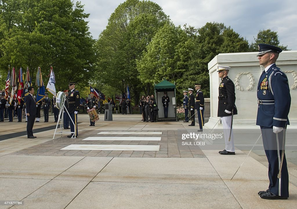 Japanese Prime Minister Shinzo Abe participates in a wreath laying ceremony at the Tomb of the Unknown Soldier at Arlington National Cemetery in...